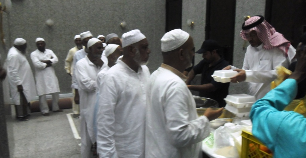 Nazer / Hussain Al Shareef Serving Food to Pilgrims